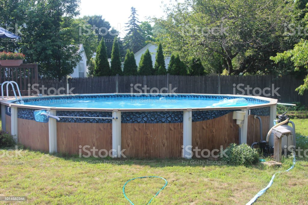 Above Ground Swimming Pool With Filter And Deck Stock Photo - Download  Image Now