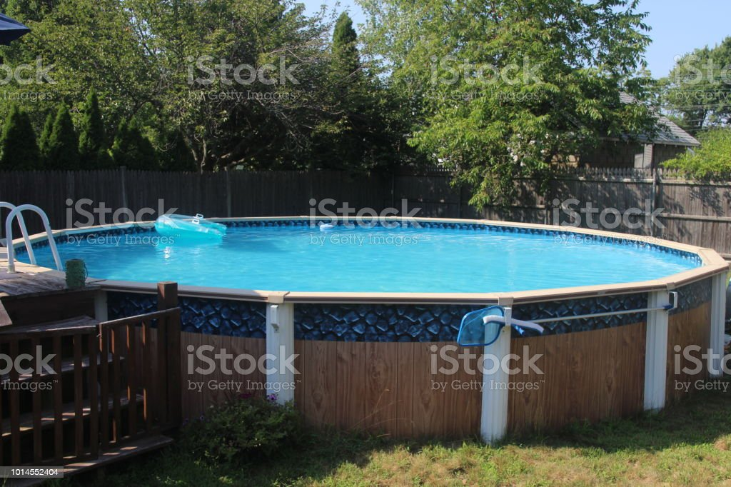 Above Ground Swimming Pool With Filter And Deck Stock Photo ...
