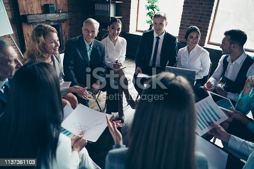 istock Above high angle view of nice stylish elegant sharks sitting on chairs in circle discussing finance plan strategy result at modern industrial loft interior work place space indoors 1137361103