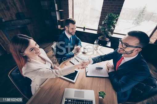 istock Above high angle view portrait of three stylish handsome cheerful investors top managers attorney lawyer contract sign agreement development in loft industrial interior work place station 1135102423