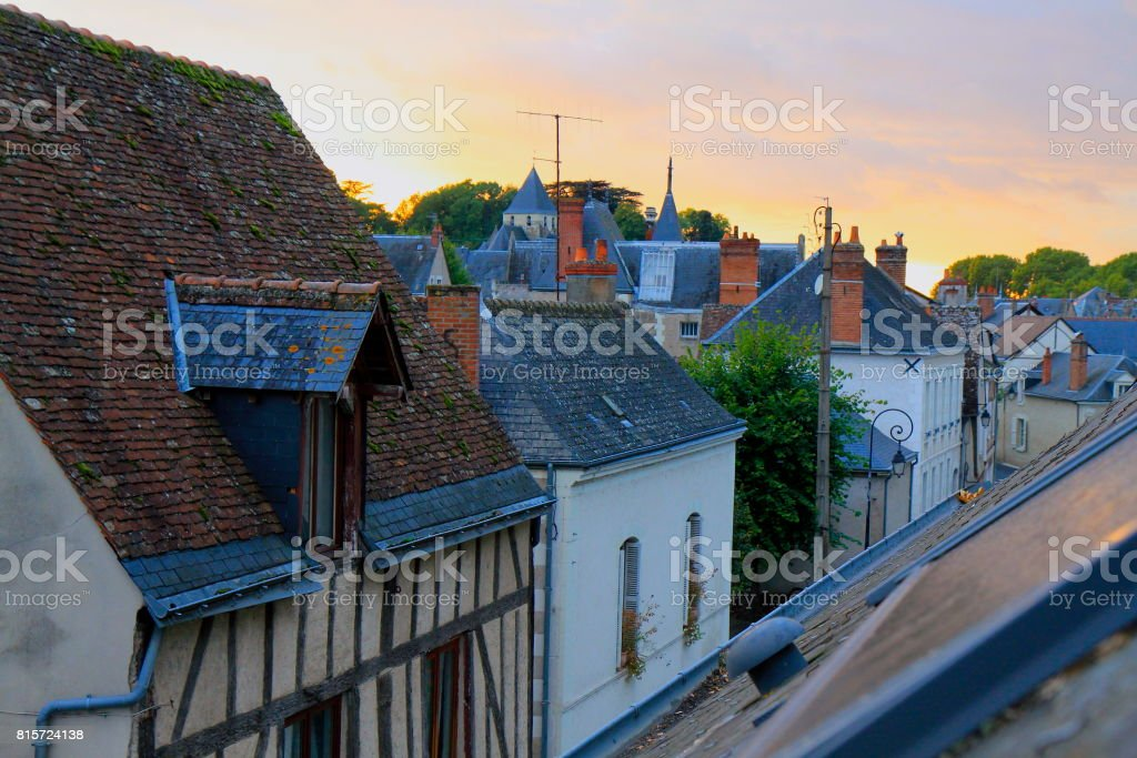 Above Medieval attic buildings in old town of Amboise, majestic Cityscape and idyllic dramatic  aky view at sunrise, gold colored autumn, Loire Valley, France stock photo