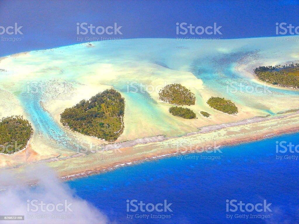 Above Polynesian Tropical Summer paradise: Sandy turquoise tropical beach, Bora Bora, Tahiti motus and reefs aerial view – Idyllic French Polynesia stock photo