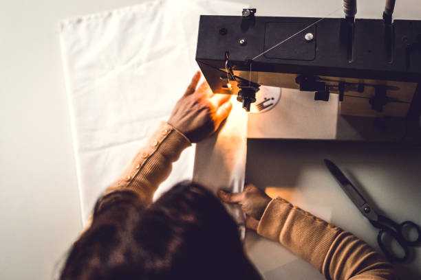 above shot of a fashion designer - sewing machine needle stock photos and pictures