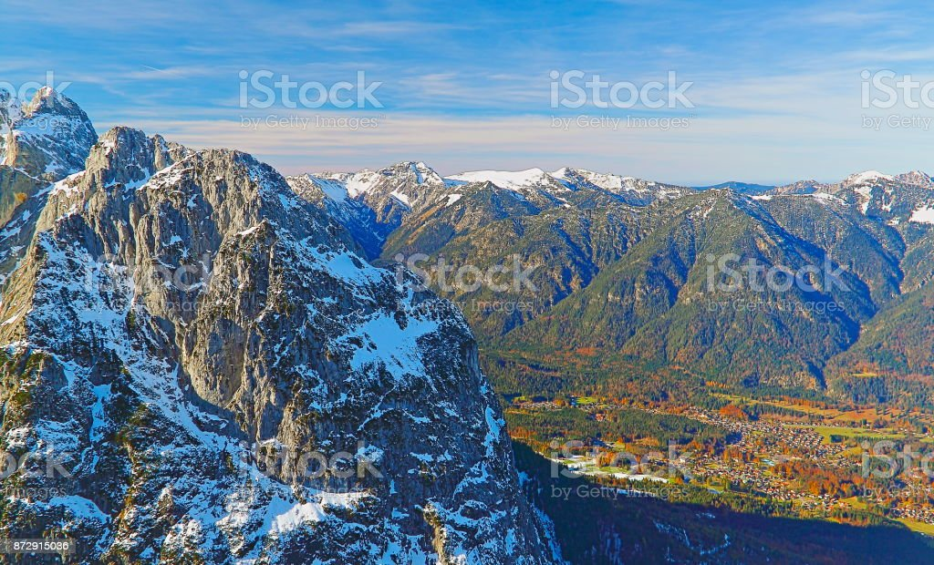 Above snowcapped Alpspitze, idyllic green valley landscape from mountain peak, majestic bavarian alps, dramatic Bavaria german Snowcapped mountain range panorama, Garmisch Partenkirchen, Germany stock photo