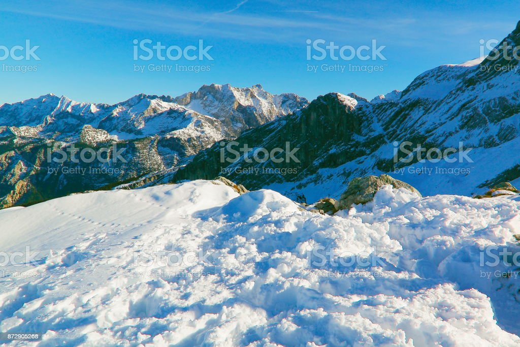 Above snowcapped Alpspitze, idyllic landscape from mountain peak,...
