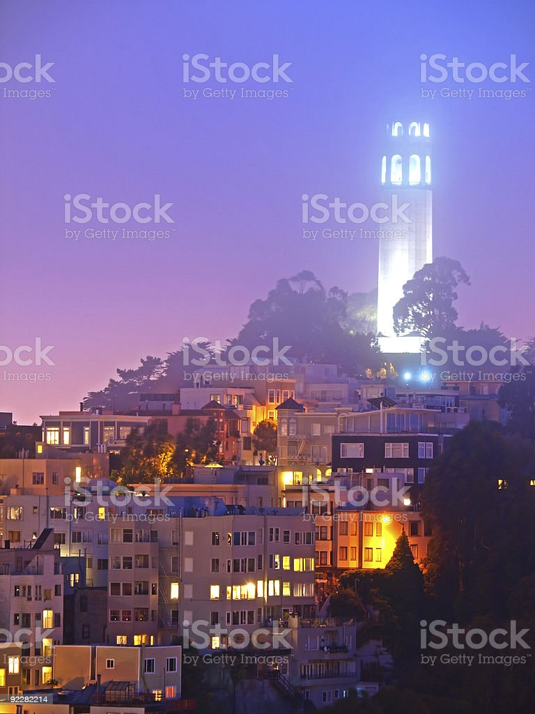 Above the city a tower is lit up stock photo