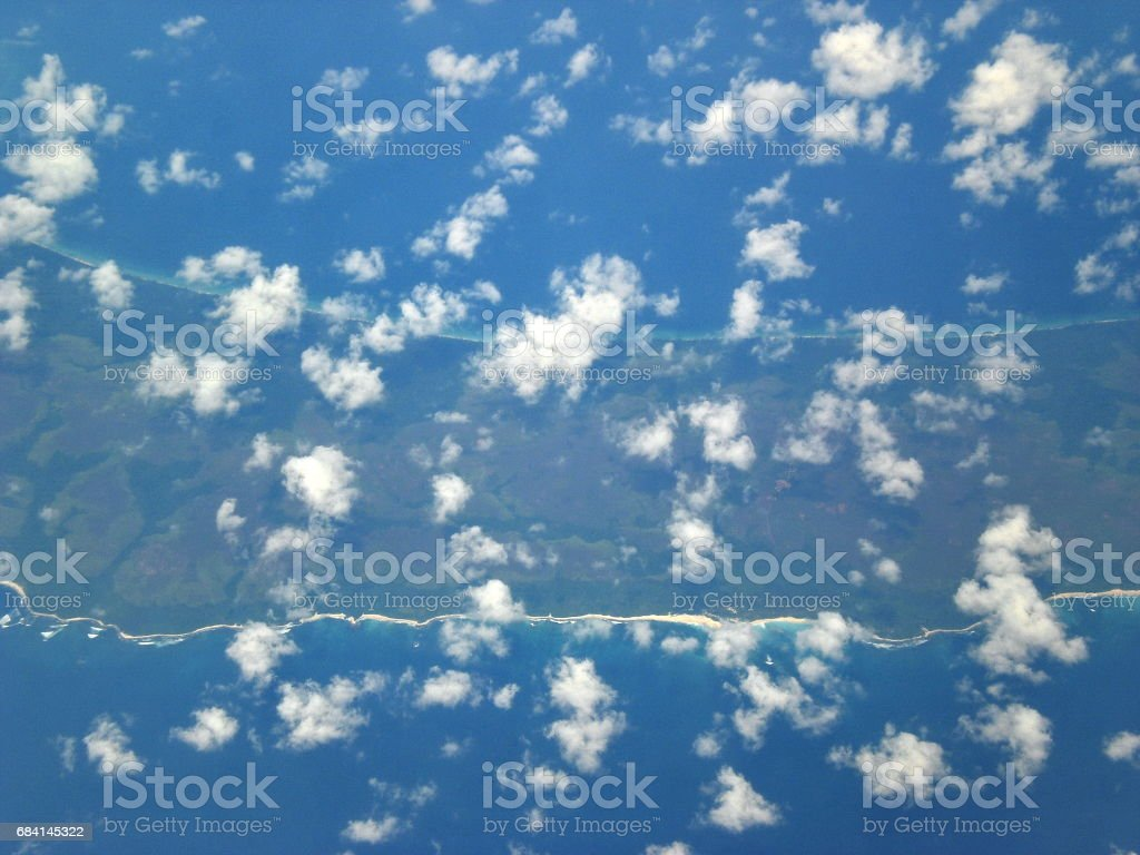 Above the clouds and island foto stock royalty-free