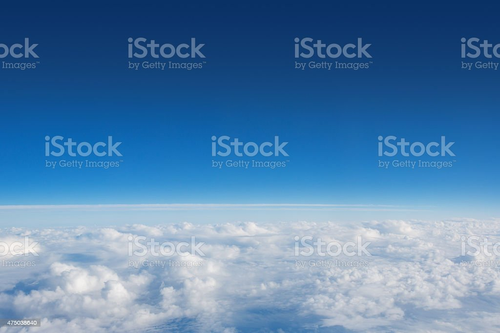 Above The Clouds Photo of puffy clouds stock photo