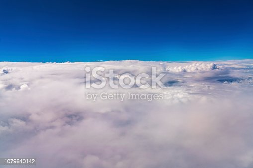 184857129istockphoto Above the clouds 1079640142