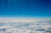 puffy clouds and blue sky from above the clouds.