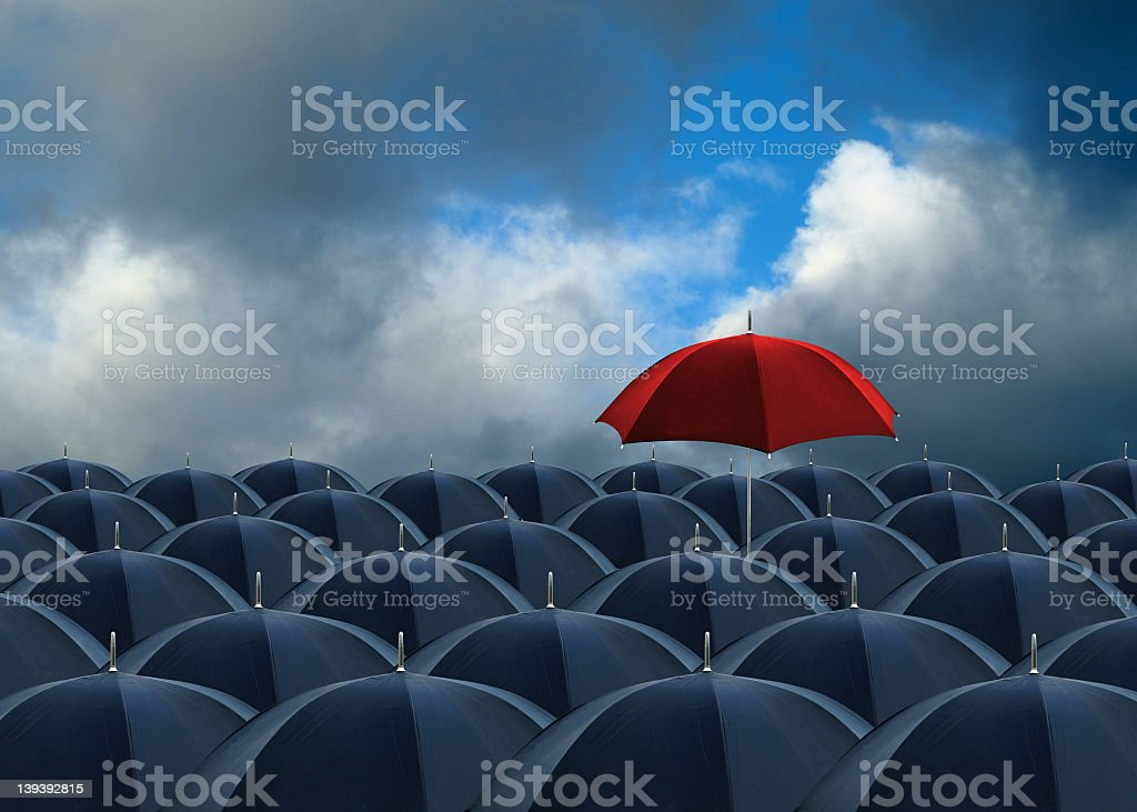 above the rest rows of umbrellas with one red one above the rest Above Stock Photo