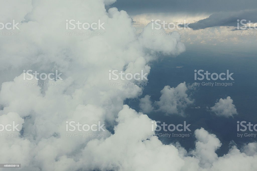 Stormy clouds seen through the window of an aircraft.