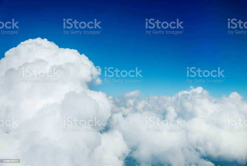 Above the white fluffy clouds stock photo