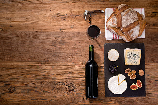 above view flatlay assortment cheese and wine wooden table copyspace stock photo