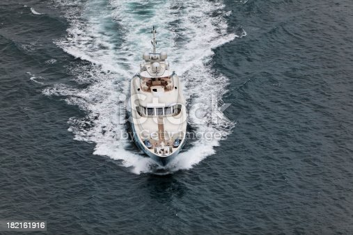 642777700 istock photo Above view motor yacht in motion 182161916