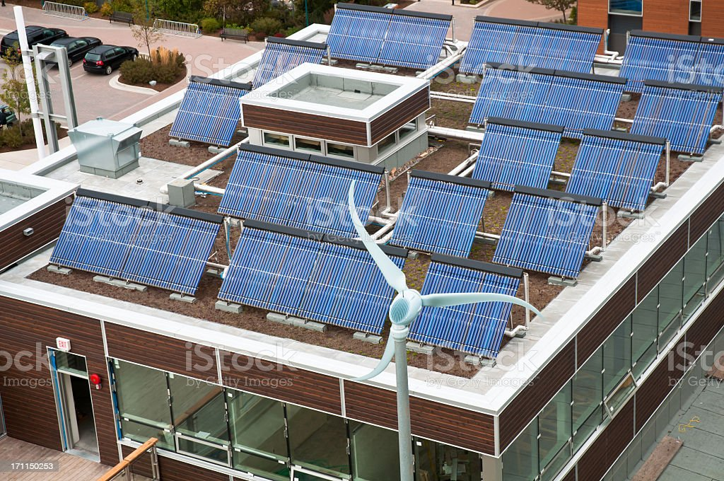 Above view of a brown rectangle building with solar panels stock photo