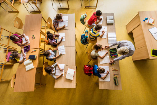 above view of a class at elementary school. - primary school stock pictures, royalty-free photos & images