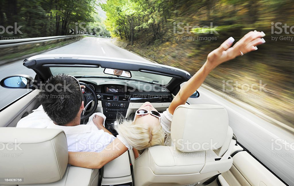 Above view of a couple driving in car. stock photo