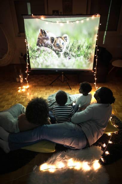 above view of a relaxed black family having a movie night at home. - tv e familia e ecrã imagens e fotografias de stock