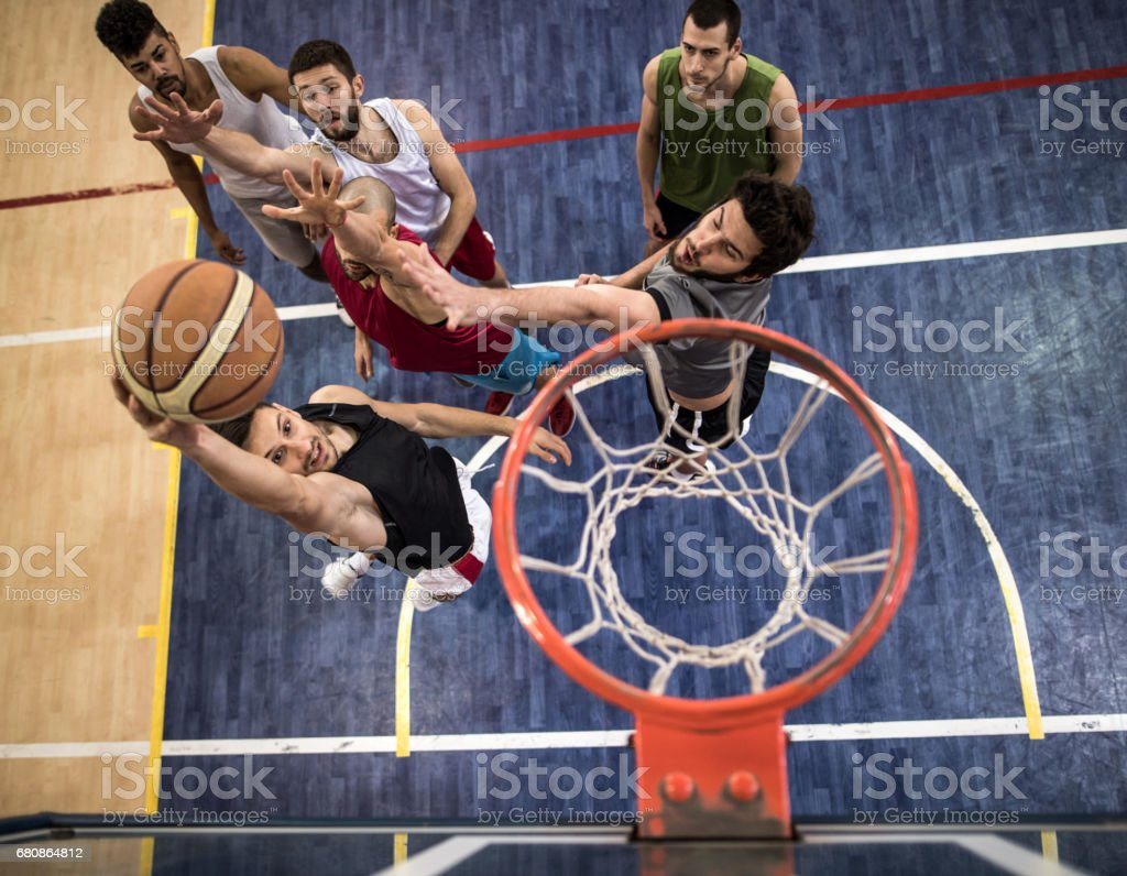 Above view of basketball players in action on a court. stock photo