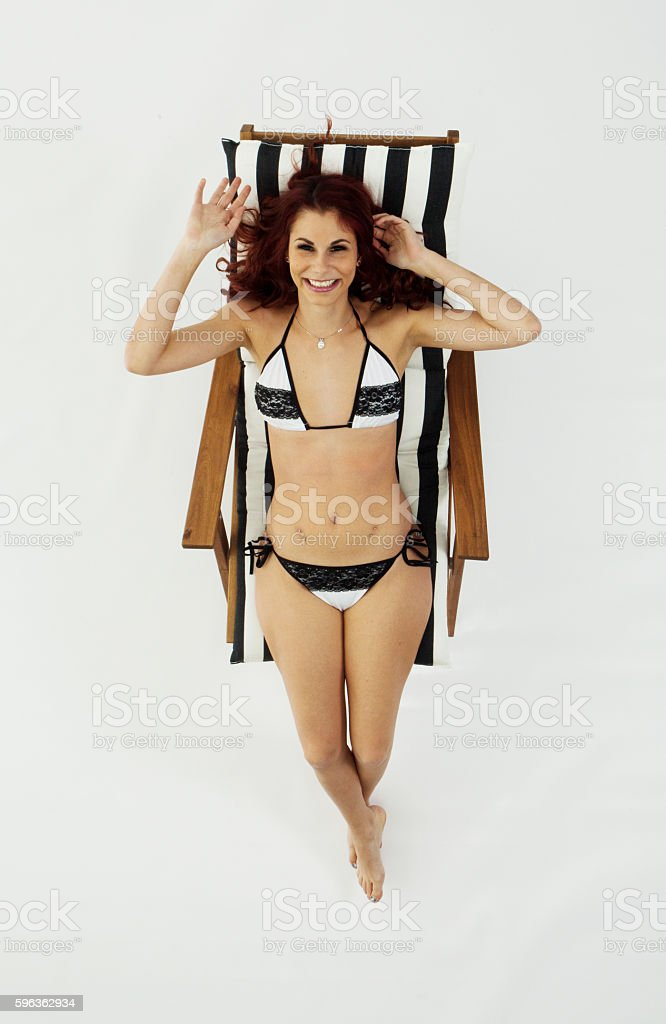 Above view of bikini woman sitting on deck chair royalty-free stock photo