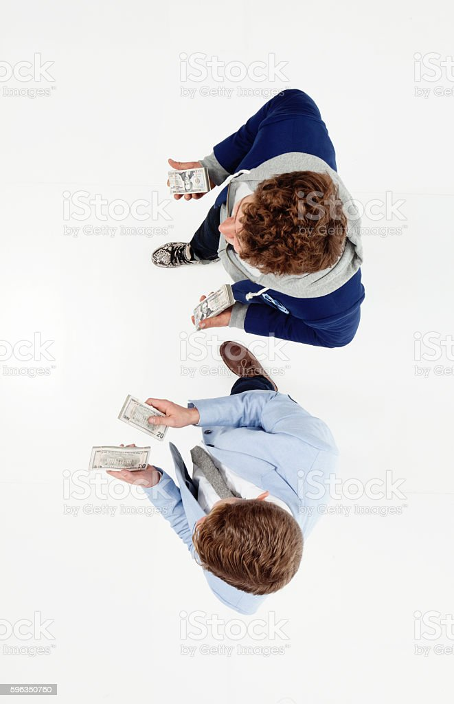 Above view of brothers holding money royalty-free stock photo
