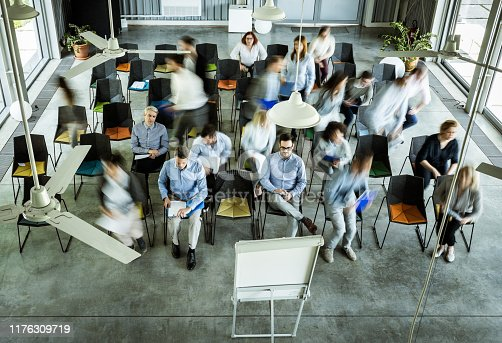 istock Above view of business people among their colleagues in blurred motion on a seminar. 1176309719