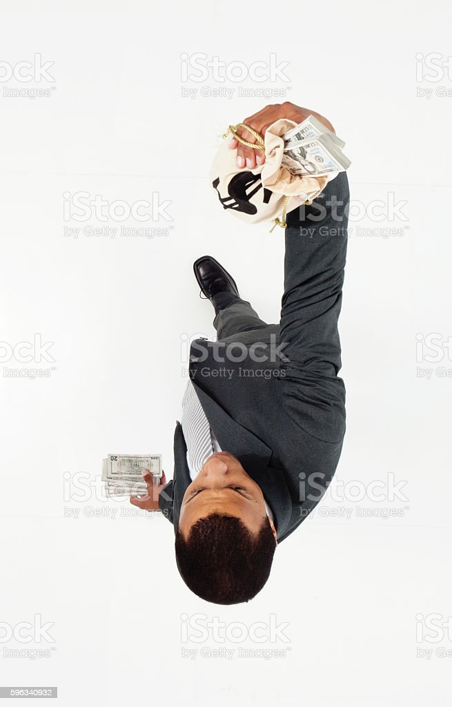 Above view of businessman holding money bag royalty-free stock photo