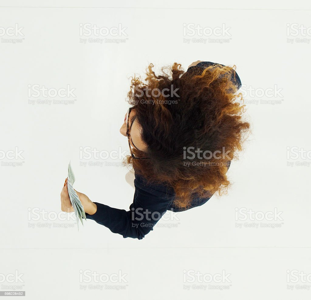 Above view of businesswoman holding money foto royalty-free