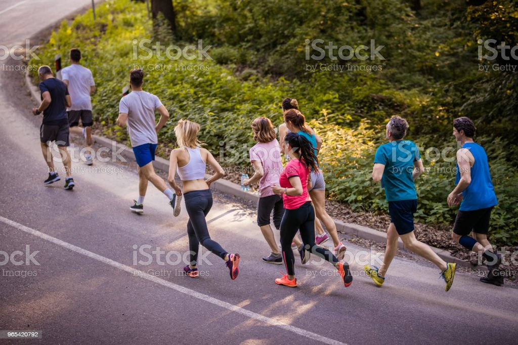 Above view of competitive group of athletes running a marathon. zbiór zdjęć royalty-free