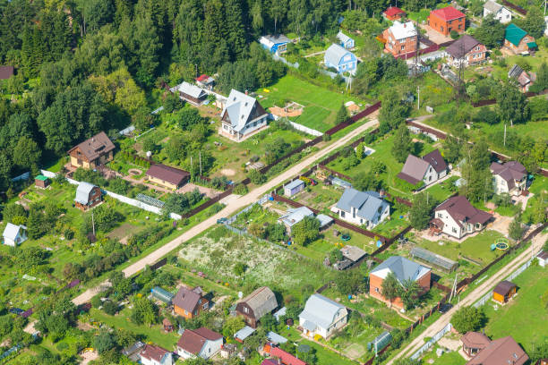 above view of cottages in suburb village in summer above view of cottages in suburb village in Moscow Region in Istrinsky district in summer day russian dacha stock pictures, royalty-free photos & images