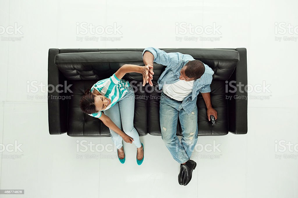 Above view of couple giving high five stock photo