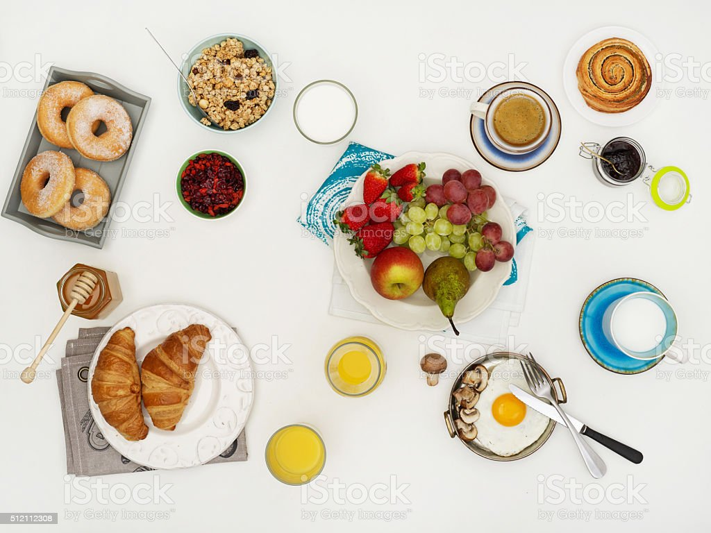Above view of dinner table with breakfast stock photo