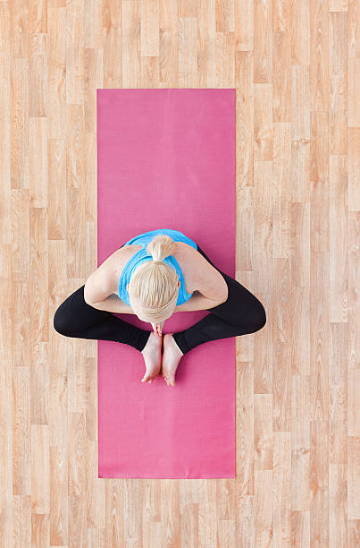 Above View Of Female Doing Yoga Stock Photo