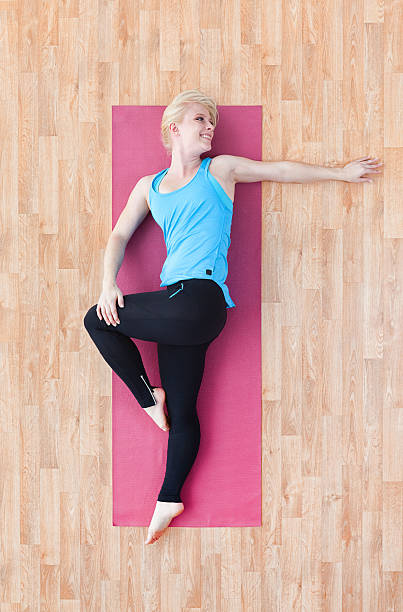 Above View Of Female Stretching Stock Photo