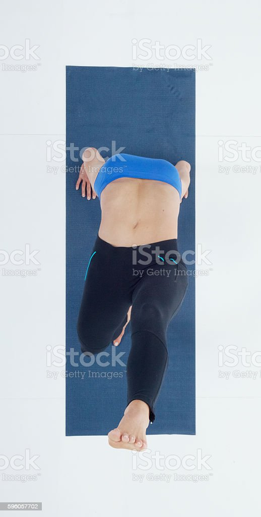 Above view of female stretching royalty-free stock photo