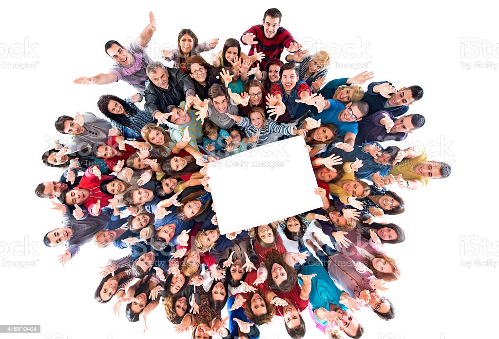 Above view of group of happy people holding white paper. stock photo