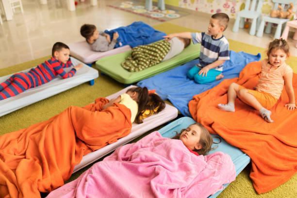 Above view of group of kids in pajamas at preschool. stock photo