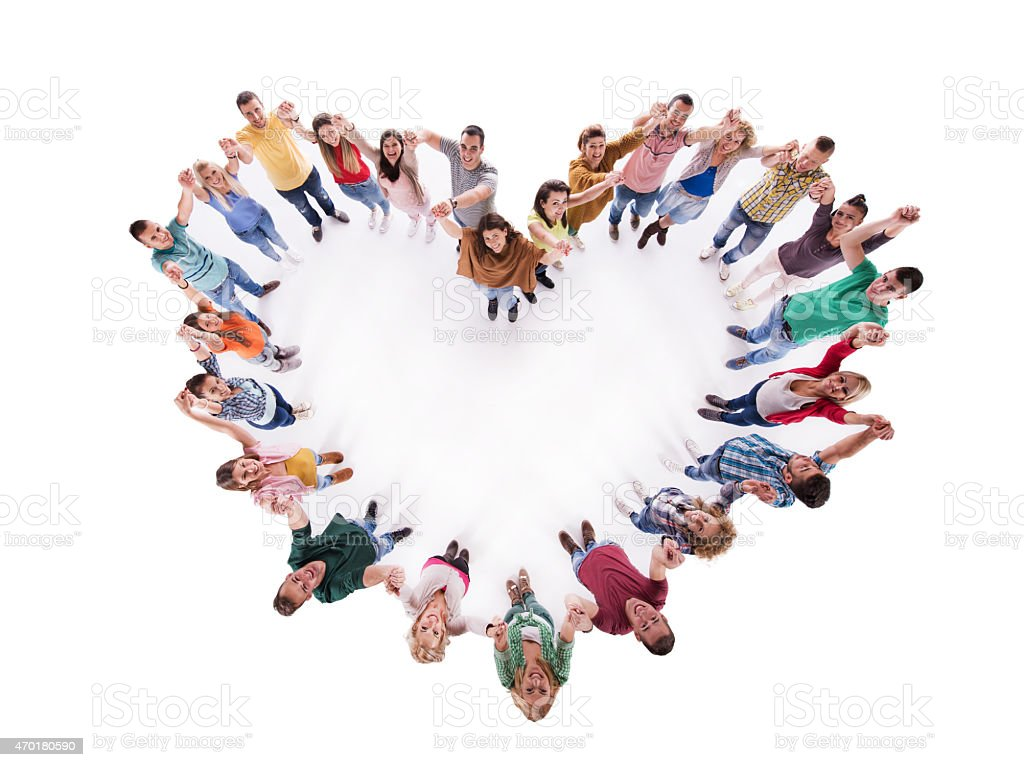 Above view of group of young people making heart shape. stock photo