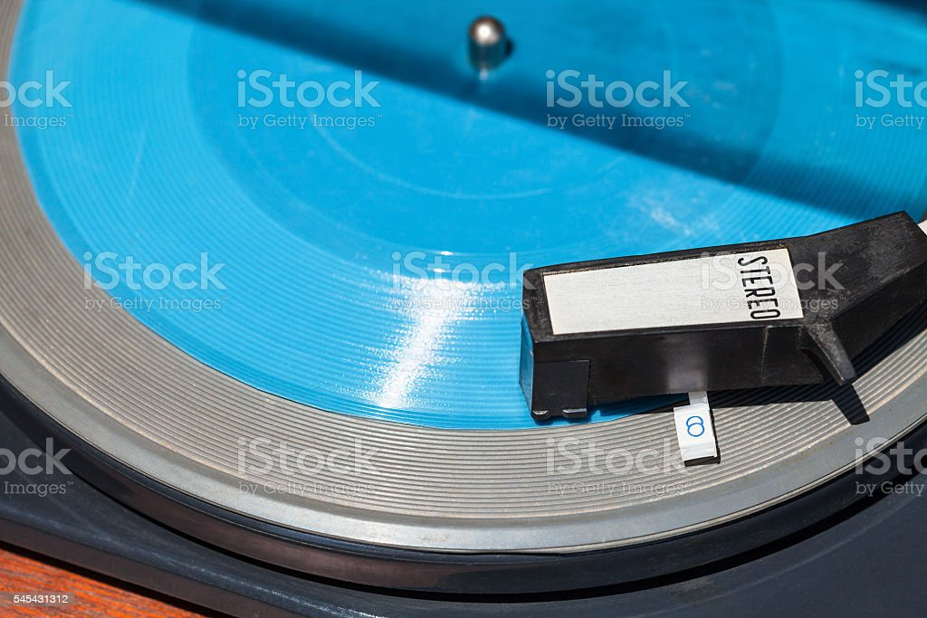 above view of headshell on blue flexi disc stock photo