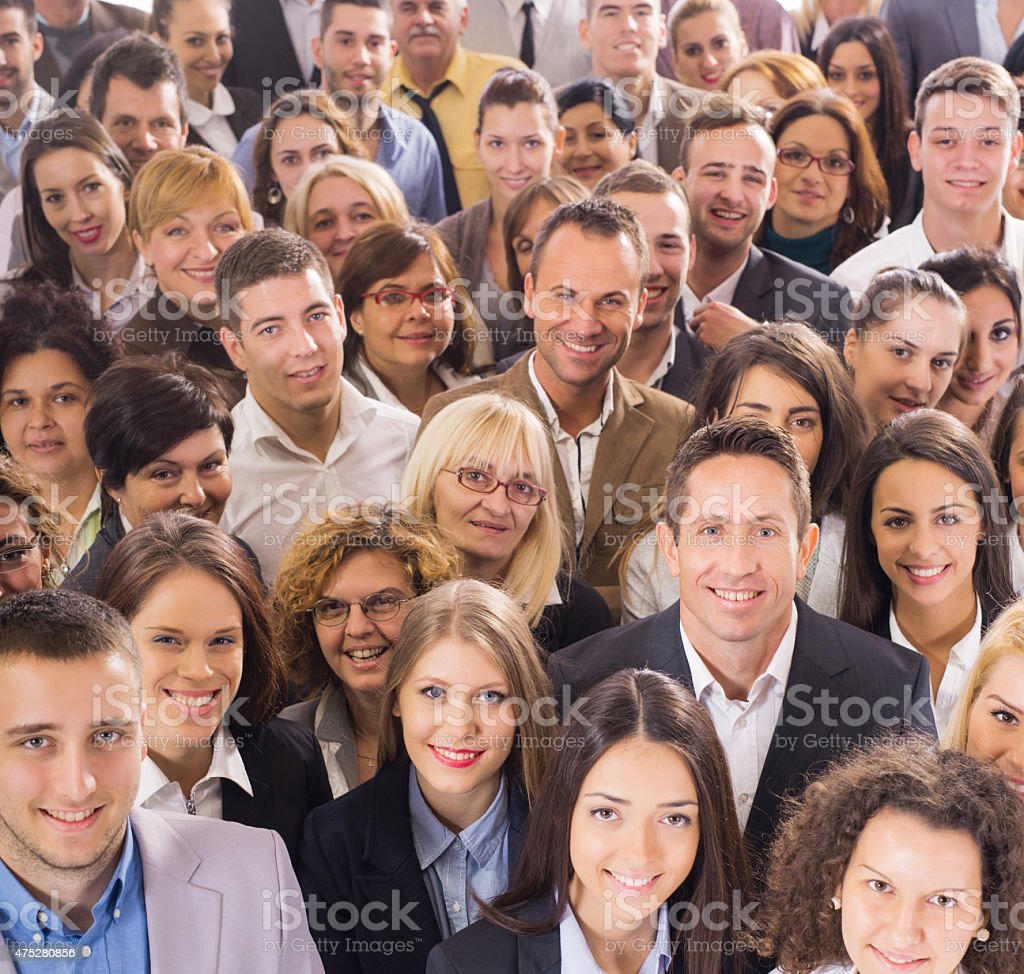 Above view of large group of smiling business people. stock photo