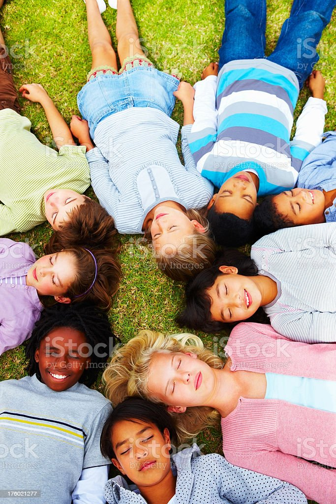 Above view of little kids lying on the grass royalty-free stock photo