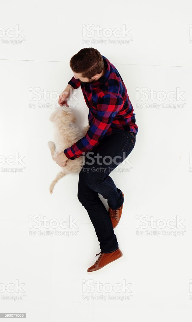 Above view of man bonding with his dog royalty-free stock photo