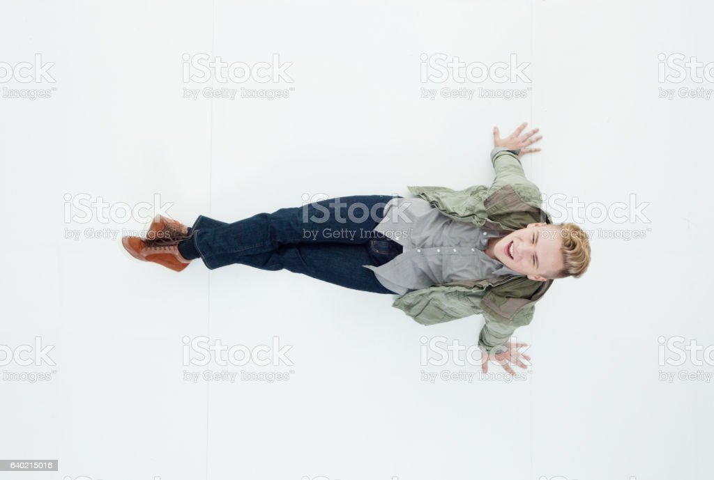 Above view of man lying on floor - Photo
