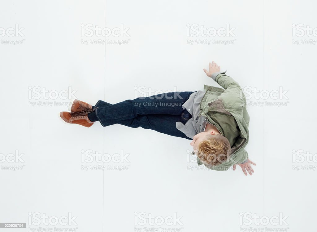 Above view of man sitting on floor - Photo