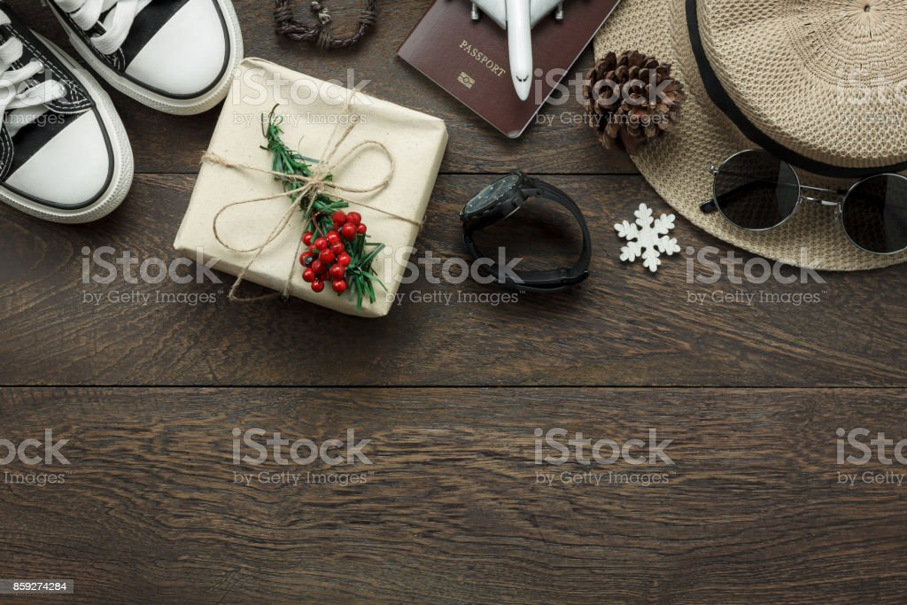 Above view of ornaments and decorations Merry Christmas and Happy New Year with accessory to travel concept background.several sign item on modern rustic home office desk.space to creative design text stock photo