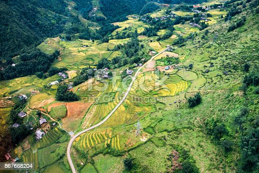 istock Above view of Tavan village and rice field terraced in valley at Sapa 867668204