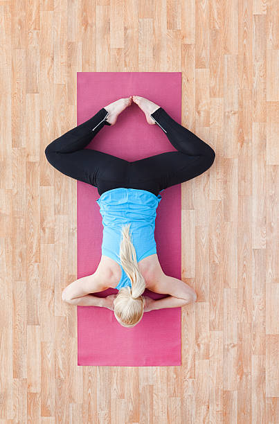 Above View Of Woman Doing Yoga Stock Photo