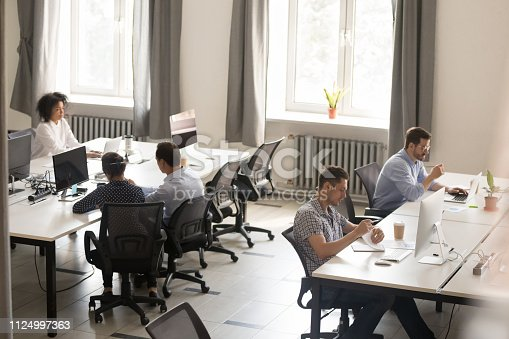 1124783373 istock photo Above view office and workers sitting at desk 1124997363