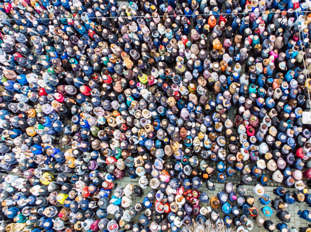 above view on crowd. big amount of people. - crowded stock pictures, royalty-free photos & images